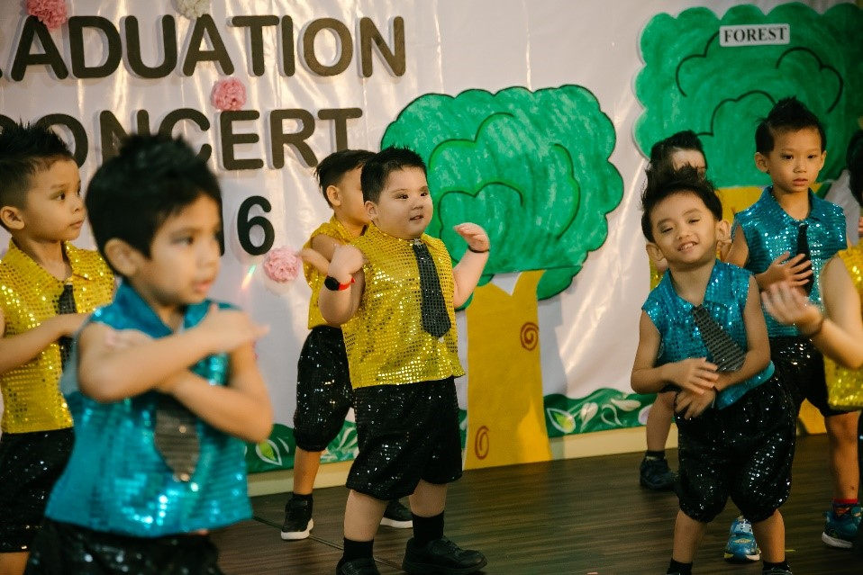"""""""Modern Dance"""" by Nursery boys. Their expressions tell you how much they enjoyed themselves throughout the dance. Their performance won much applause from the audience."""